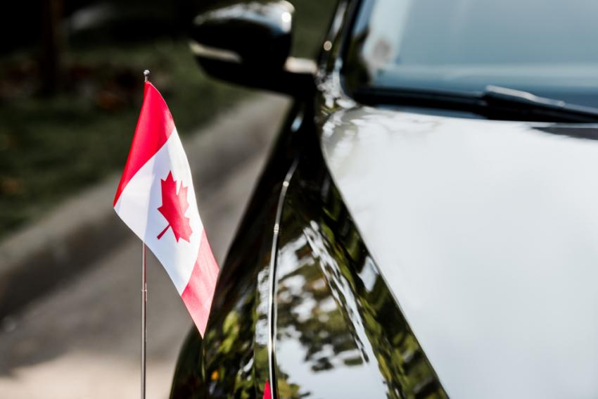 Image depicting car and Canadian flag
